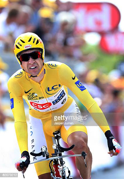 Race leader Carlos Sastre of Spain and team CSC Saxo Bank crosses the finishline at the end of the final time trail of the 2008 Tour de France from...