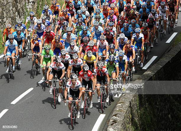 Race leader Carlos Sastre of Spain and team CSC Saxo Bank, wearing the yellow jersey, rides amid the peloton during stage eighteen of the 2008 Tour...