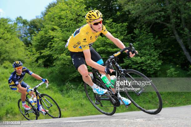 Race leader Chris Froome of Great Britain and Sky Procycling is followed by Alberto Contador of Spain and Team SaxoTinko on the decent of the Col De...