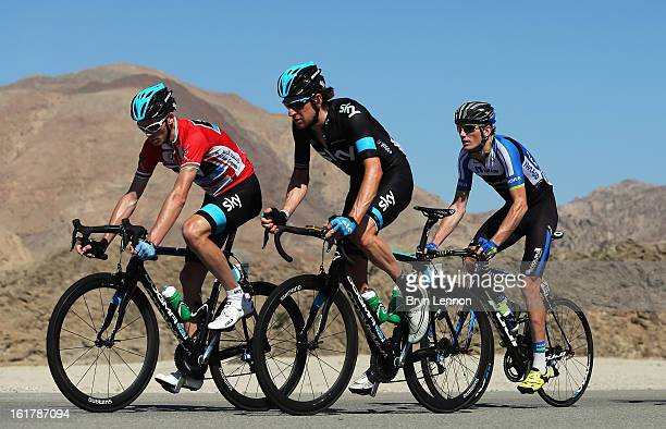Race leader Chris Froome of Great Britain and SKY Procycling rides with team mate Sir Bradley Wiggins during stage six of the 2013 Tour of Oman from...