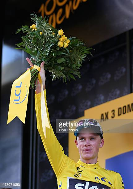 Race leader Chris Froome of Great Britain and Team Sky Procycling celebrates on the podium after winning stage eight of the 2013 Tour de France a...