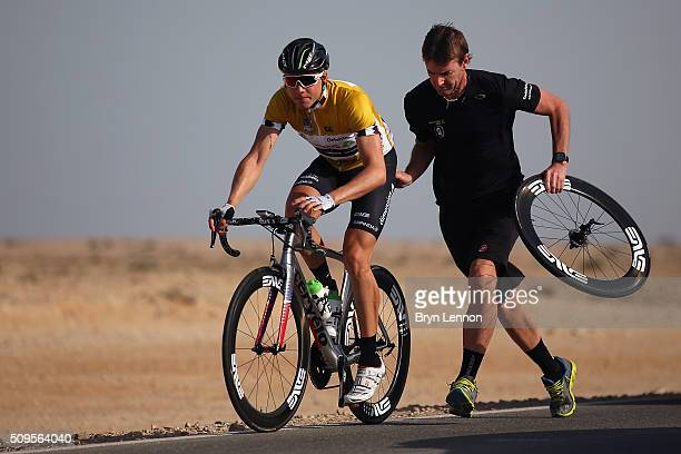 Race leader Edvald Boasson Hagen of Norway and Dimension Data receives assitance from his mechanic after suffering a rear puncture earlier in the...