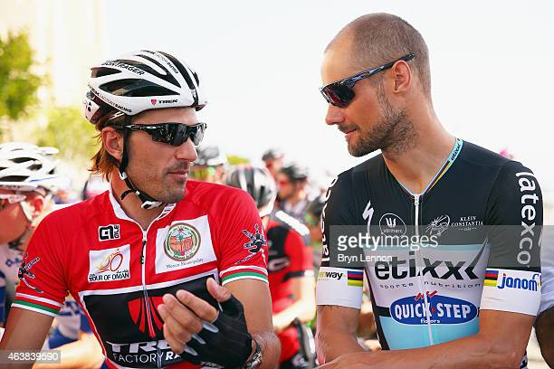 Race leader Fabian Cancellara of Switzerland and Trek Factory Racing chats to Tom Boonen of Belgium and Etixx QuickStep at the start of stage three...