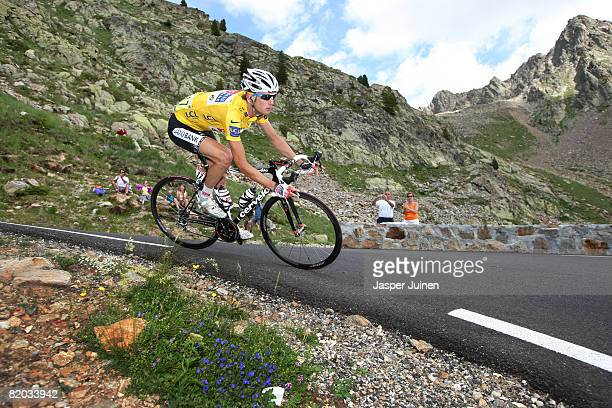 Race leader Frank Schleck of Luxembourg and team CSC Saxo Bank decents in the yellow jersey the Col de la Lombarde during stage sixteen of the 2008...