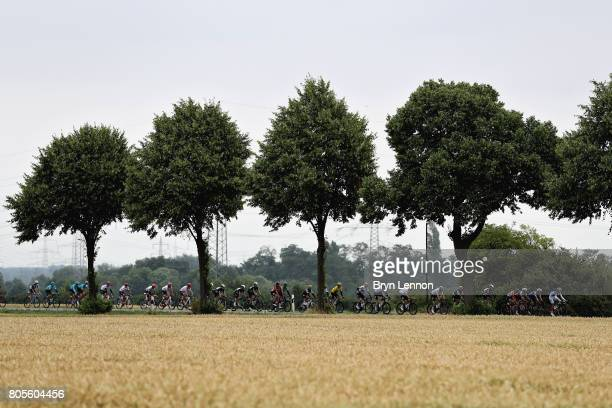 Race leader Geraint Thomas of Great Britain and Team Sky rides in the peloton during stage two of the 2017 Tour de France a 2035km road stage from...