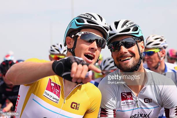 Race leader Niki Terpstra of The Netherlands and Etixx QuickStep chats to team mate Tom Boonen of Belgium at the start of stage four of the 2015 Tour...