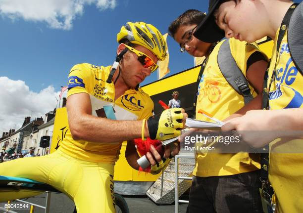 Race leader Rinaldo Nocentini of Italy and AG2R La Mondiale signs autographs at the start of stage 11 of the 2009 Tour de France from Vatan to...