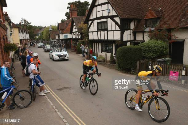Race leader Sir Bradley Wiggins passes through the small village of Shere during stage seven of the Tour of Britain from Epsom Racecourse to...