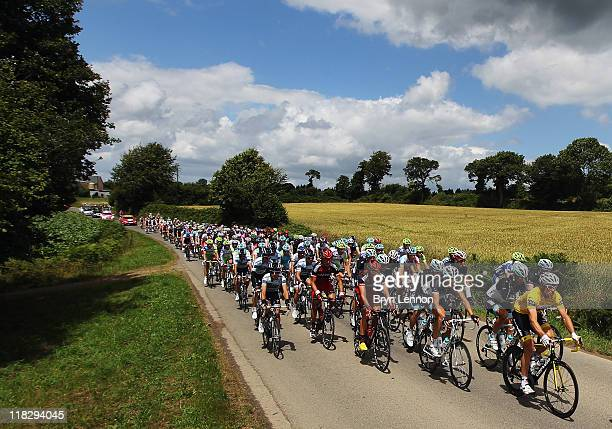 Race leader Thor Hushovd of Norway and Team GarminCervelo rides at the front of the peloton on stage five of the 2011 Tour de France from Carhaix to...