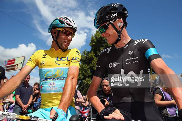 Race leader Vincenzo Nibali of Italy and the Astana Pro Team chats to Chris Froome of Great Britain and Team SKY at the start of the third stage of...