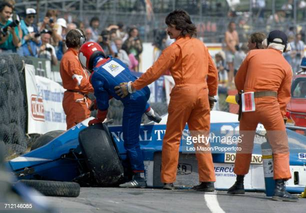 Race marshals help Canadian racing driver Allen Berg from his crashed Osella Squadra Corse Osella FA1H Alfa Romeo V8 after a multiple crash on the...