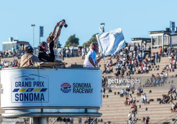 A race official brings out the white flag toward the end of the IndyCar Grand Prix of Sonoma on Sunday September 16 2018 at the Sonoma Raceway Sonoma...