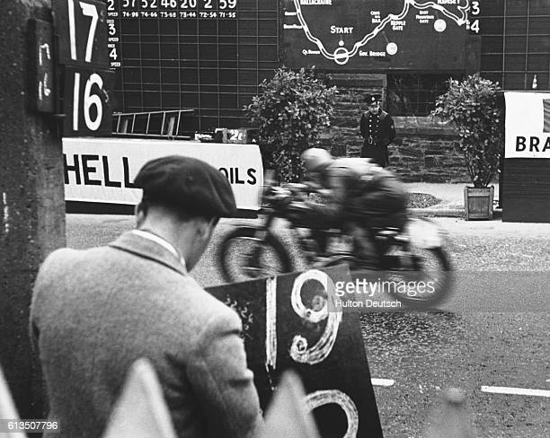A race official records the progress of a competitor in a Senior TT event a motorcycle race on the Isle of Man 1950