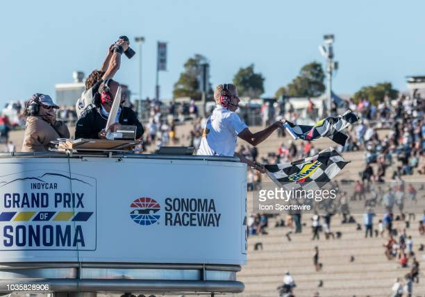 A race official waves the checkered flag at the end of the IndyCar Grand Prix of Sonoma on Sunday September 16 2018 at the Sonoma Raceway Sonoma...