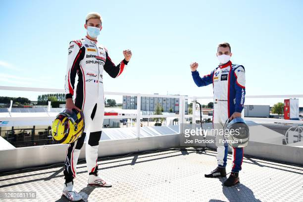 Race one winner in Hungary Theo Pourchaire of France and ART Grand Prix and race two winner David Beckmann of Germany and Trident pose for a photo...
