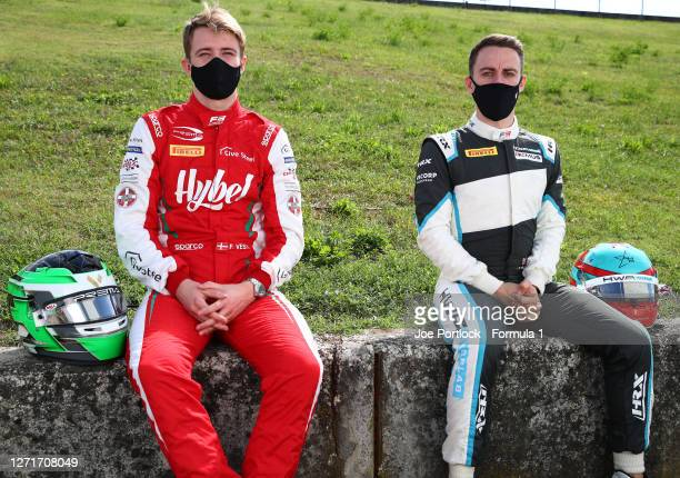 Race one winner in Monza, Frederik Vesti of Denmark and Prema Racing and race two winner Jake Hughes of Great Britain and HWA Racelab pose for a...