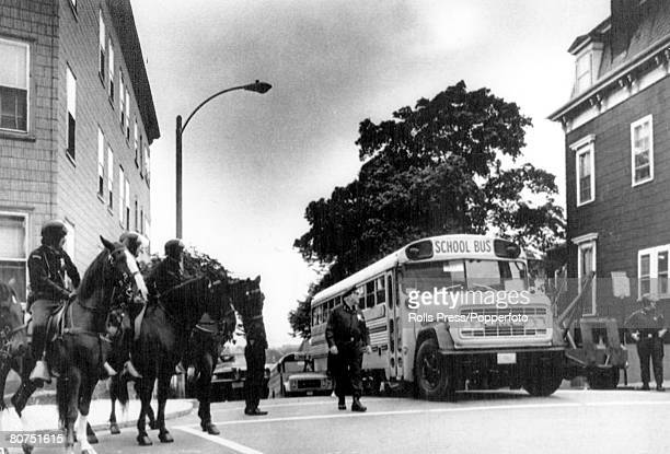 1974 Boston Mass Mounted police look on as buses carrying black students arrive for classes in the early days of school desegregation in South Boston
