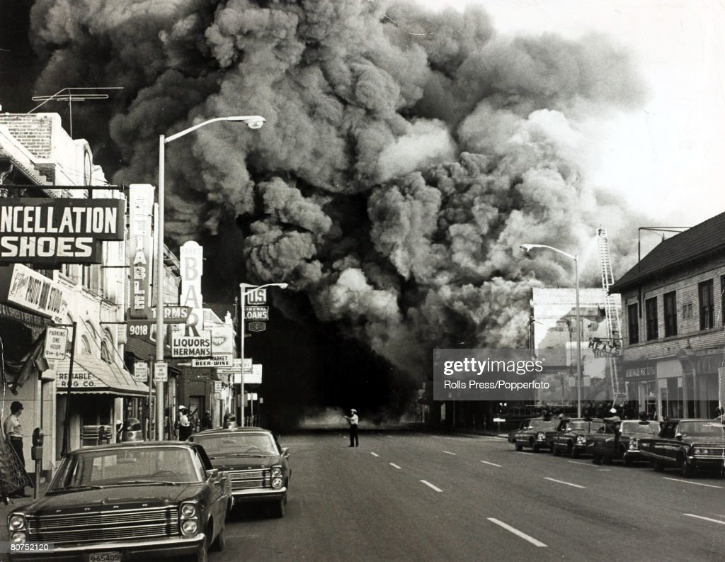 Race Riots U.S.A. pic: 1967. Detroit, Michigan. A huge pall of smoke pours from a burning building during race riots in the city. : News Photo
