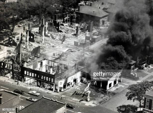 27th July 1967 Detroit Michigan The gutted remains of buildings and a huge pall of smoke pouring from a burning buildings during race riots in the...