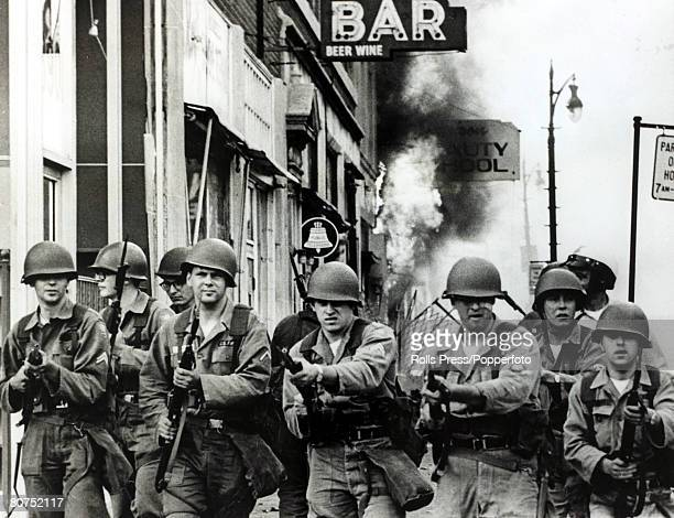27th July1967 Detroit Michigan Tough looking Michigan National Guardsmen with fixed bayonets on the streets during race riots in the city