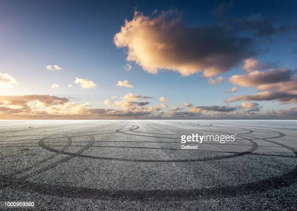 race road against sunset - airport runway stock pictures, royalty-free photos & images