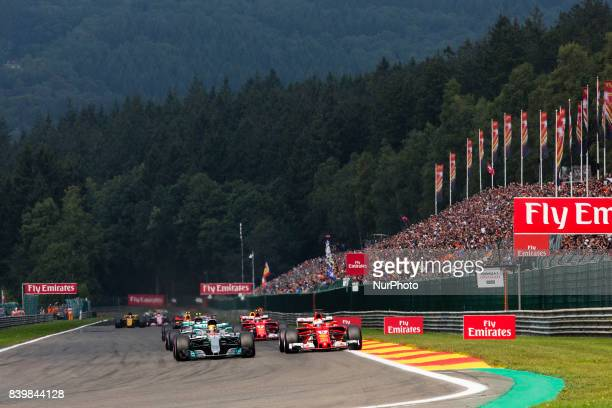 Race start with 44 HAMILTON Lewis from Great Britain of team Mercedes GP and 05 VETTEL Sebastian from Germany of scuderia Ferrari ahead of the group...
