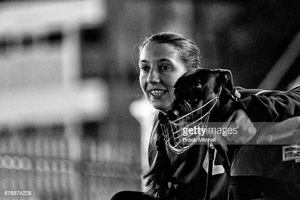 A race steward and greyhound at Wentworth Park on July 16 2016 in Sydney Australia Greyhound Racing in NSW has now resumed after a week suspension...
