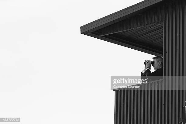 A race steward watches racing from a tower on Stakes Day at Flemington Racecourse on November 8 2014 in Melbourne Australia
