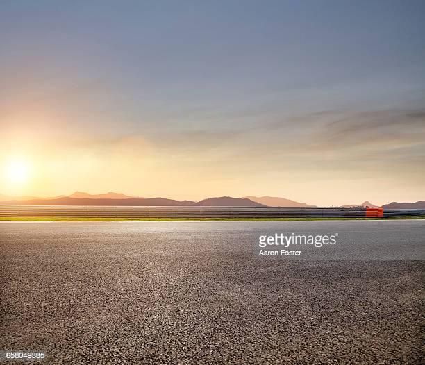 race track sunset edit - asfalt stockfoto's en -beelden