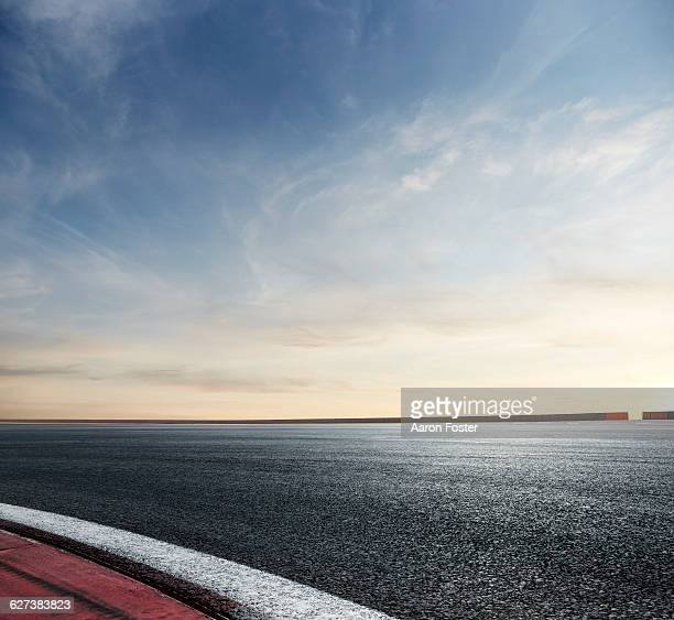 race track sunset - motor racing track stock pictures, royalty-free photos & images