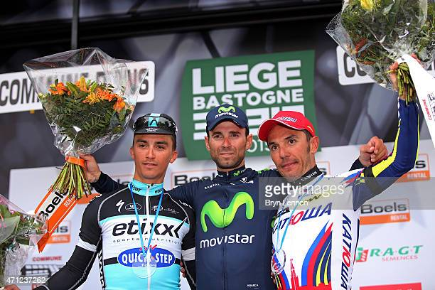 Race winner Alejandro Valverde of Spain and Movistar Team celebrates his victory with second placed Julian Alaphilippe of France and Etixx - Quick...