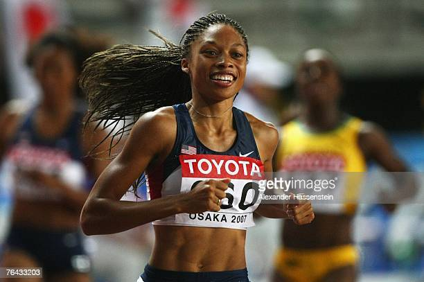 Race winner Allyson Felix of the United States of America celebrates as she crosses the finish line to win the Women's 200m Final on day seven of the...