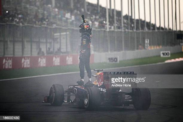 Race winner and 2013 Formula One World Champion Sebastian Vettel of Germany and Infiniti Red Bull Racing celebrates in front of the crowd by doing...