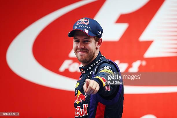 Race winner and 2013 Formula One World Champion Sebastian Vettel of Germany and Infiniti Red Bull Racing celebrates on the podium following the...