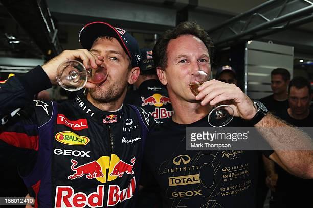 Race winner and 2013 Formula One World Champion Sebastian Vettel of Germany and Infiniti Red Bull Racing celebrates with his Team Principal Christian...