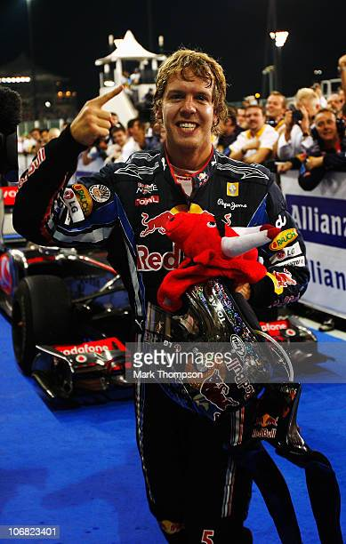 Race winner and F1 2010 World Champion Sebastian Vettel of Germany and Red Bull Racing celebrates in parc ferme following the Abu Dhabi Formula One...
