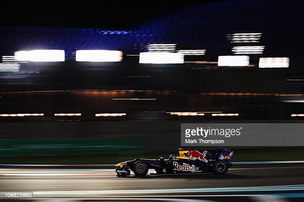 Race winner and F1 2010 World Champion Sebastian Vettel of Germany and Red Bull Racing drives during the Abu Dhabi Formula One Grand Prix at the Yas...