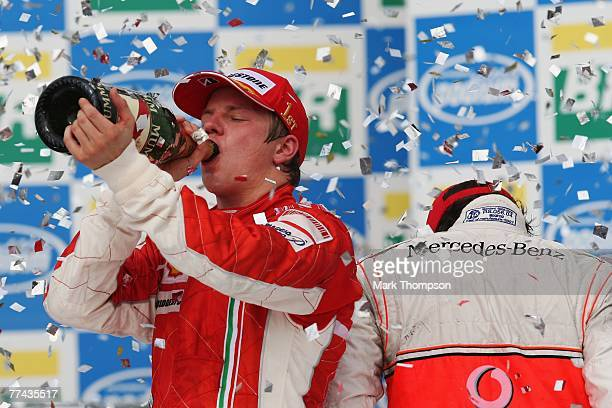 Race winner and new F1 World Champion Kimi Raikkonen of Finland and Ferrari and last years champion third placed Fernando Alonso of Spain and McLaren...
