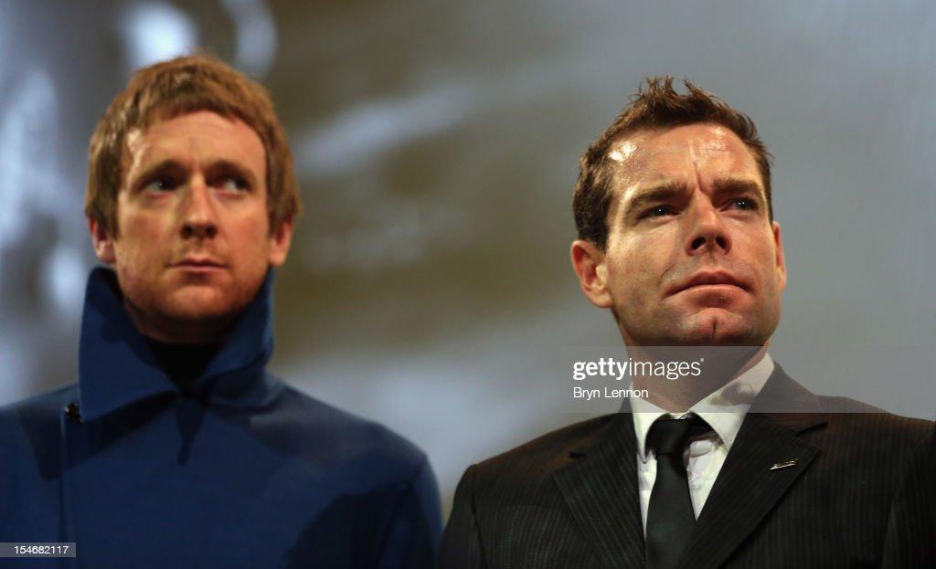 2012 race winner Bradley Wiggins (l) and Cadel Evans (r) of Australia attend the 2013 Tour de France Route Presentation at the Palais des Congres de Paris on October 24, 2012 in Paris, France.