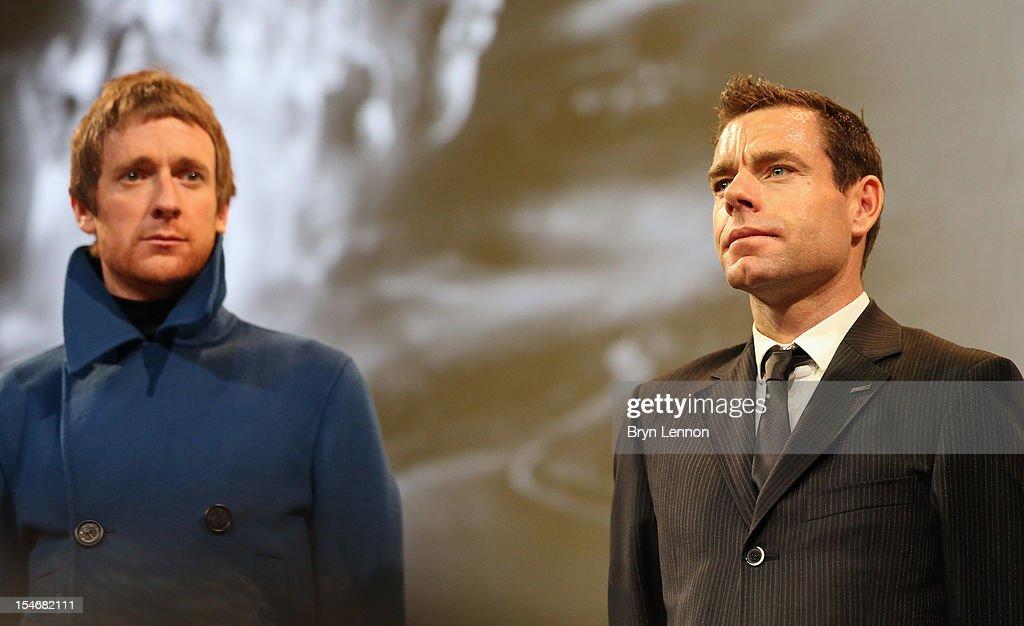 2012 race winner Bradley Wiggins (l) and Cadel Evans (r) of Australia attends the 2013 Tour de France Route Presentation at the Palais des Congres de Paris on October 24, 2012 in Paris, France.