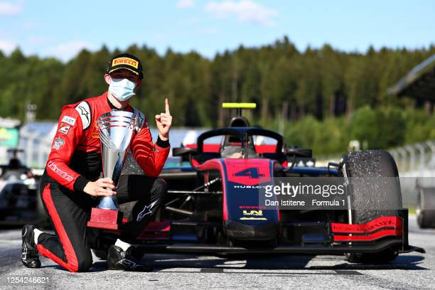 Race winner Callum Ilott of Great Britain and UNI-Virtuosi Racing celebrates on the podium during the feature race for the Formula 2 Championship at...