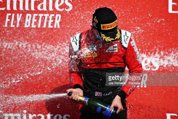 Race winner Callum Ilott of Great Britain and UNI-Virtuosi Racing celebrates on the podium during the feature race of the Formula 2 Championship at...