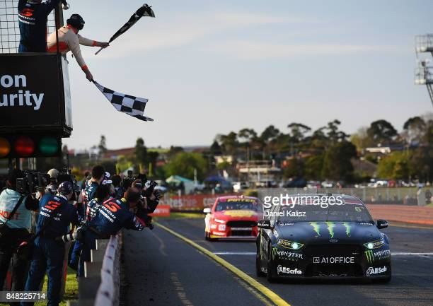 Race winner Cameron Waters drives the Monster Energy Ford Falcon FGX takes the chequred flag to win the Sandown 500 which is part of the Supercars...