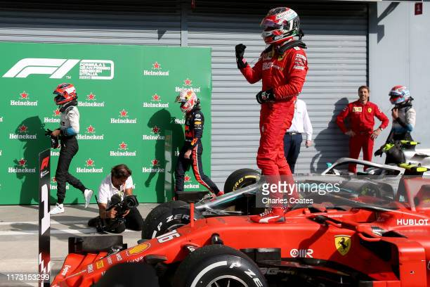 Race winner Charles Leclerc of Monaco and Ferrari celebrates in parc ferme during the F1 Grand Prix of Italy at Autodromo di Monza on September 08,...