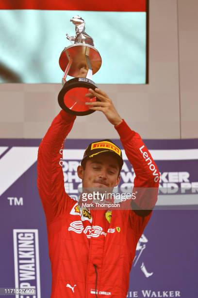 Race winner Charles Leclerc of Monaco and Ferrari celebrates on the podium during the F1 Grand Prix of Belgium at Circuit de Spa-Francorchamps on...