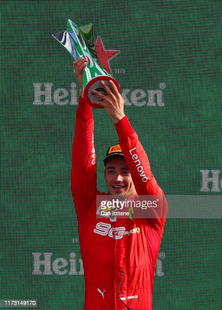 Race winner Charles Leclerc of Monaco and Ferrari celebrates on the podium during the F1 Grand Prix of Italy at Autodromo di Monza on September 08...