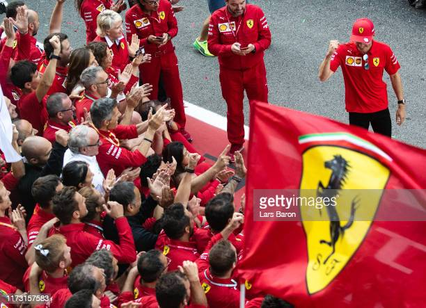 Race winner Charles Leclerc of Monaco and Ferrari celebrates with his team after the F1 Grand Prix of Italy at Autodromo di Monza on September 08...