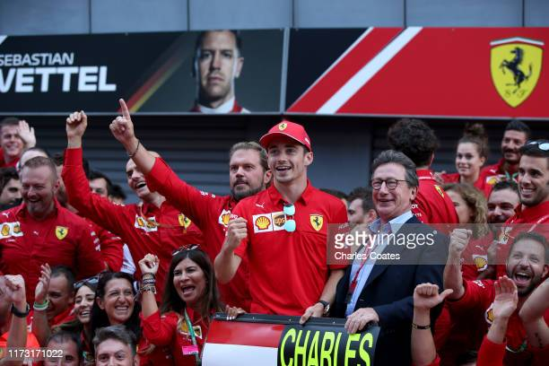 Race winner Charles Leclerc of Monaco and Ferrari celebrates with Ferrari CEO Louis C. Camilleri and his team after the F1 Grand Prix of Italy at...