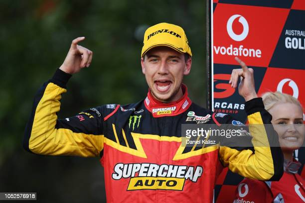 Race winner Chaz Mostert driver of the Supercheap Auto Racing Ford Falcon FGX celebrates on the podium during the Supercars Gold Coast 600 on October...