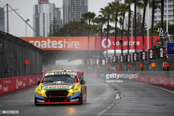 Race winner Chaz Mostert drives the Supercheap Auto Racing Ford Falcon FGX takes the chequered flag to win race 21 for the Gold Coast 600 which is...